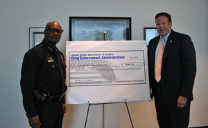 Chief Brown Accepts Check From DEA