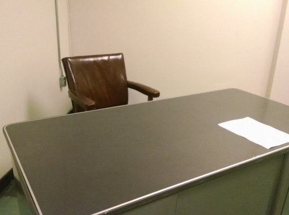 The desk Lee Harvey Oswald was sitting at during his interrogation.