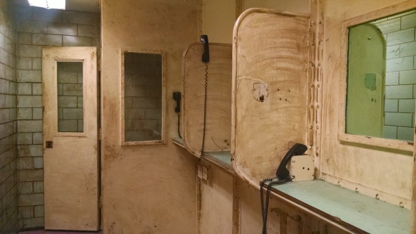 Lawyers can speak with clients in the last stall that was enclosed with a door for privacy.